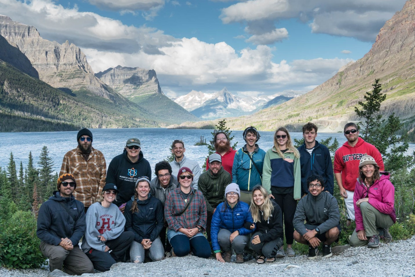 Geology students pose in front of a lake.