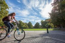 Girl on a Bike with a clear sky in the background