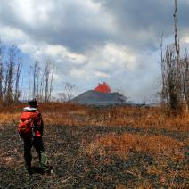 A UO geologist observes the erupting Kilauea volcano.