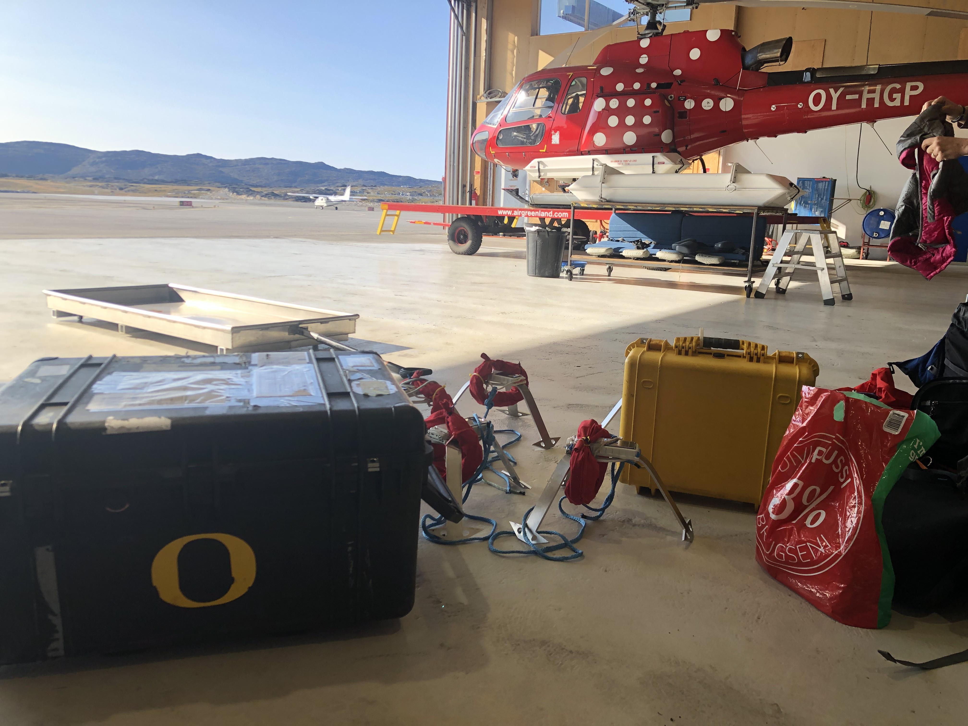 Sampling equipment with a helicopter in the background.